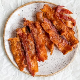 A plate with crispy air fryer bacon strips