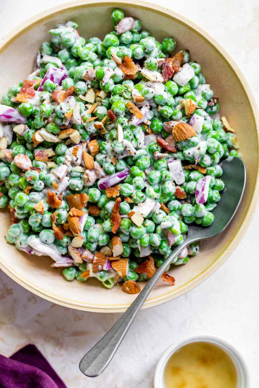 fresh pea salad with almonds and bacon
