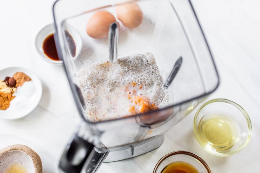 batter ingredients in a blender for fluffy gluten free buckwheat pumpkin pancake batter