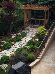 landscape-Oakville backyard stone steps leading to wooden pergola