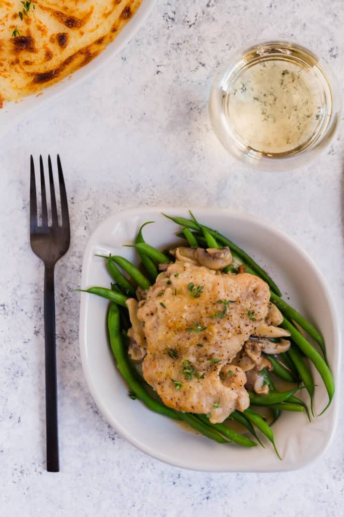 Chicken with mushrooms and white wine garlic sauce