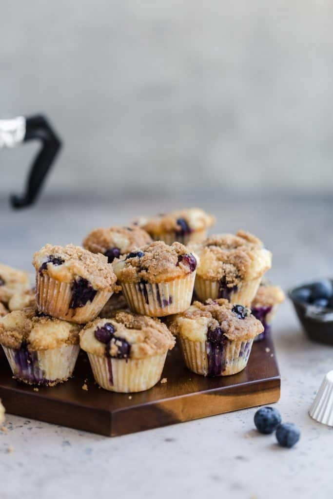 miniblueberry streusel muffins on wood platter