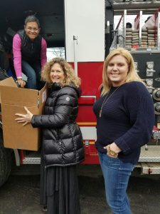 Wellspring employees unloaded toys from a Gloucester Fire Department fire engine. Gloucester Fire Department went above and beyond with their donations this year!
