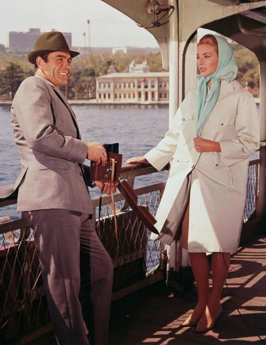 Sean Connery and Daniela Bianchi are standing together on the Istanbul ferry