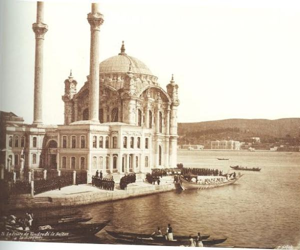 The Sultan Attending Friday Prayers at the Mosque, Constantinople, ca. 1860s. The Friday prayers were one of the rare occasions on which the otherwise secluded Sultan would appear in public. The boat which was used by Sultan Abdülaziz to reach the Ortaköy Mosque is visible in the picture. This Mosque had been made by the Balyan family on behalf of Sultan Abdülmecid.