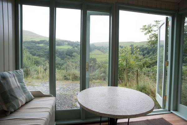 Ty Mari's garden room is a cosy quiet place apart
