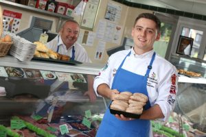 Higher Apprentice of the Year finalist, Matthew Edwards, Vaughan's Family Butchers, Penyffordd near Wrexham, with shop owner, Steve Vaughan helped by cambrian training