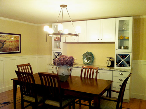 dining room with wainscoting and built-in buffet