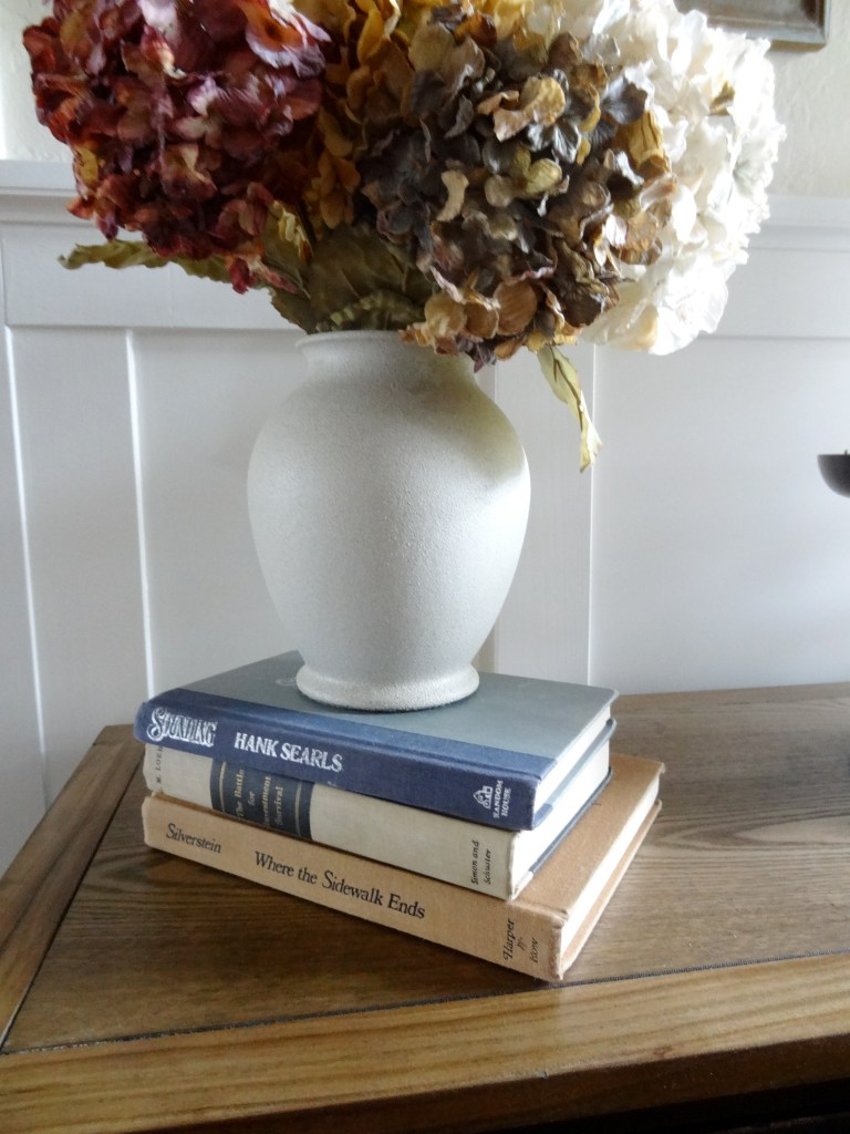 easy inexpensive decorating using a stack of books