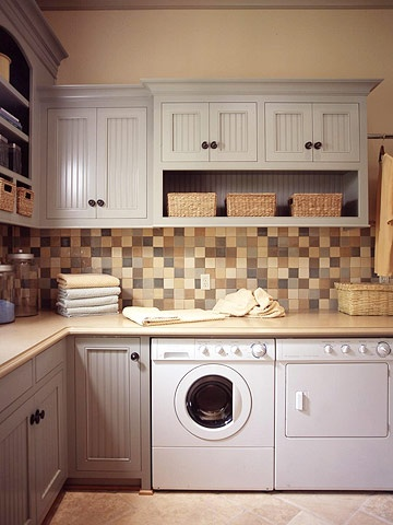 gray cabinets laundry room
