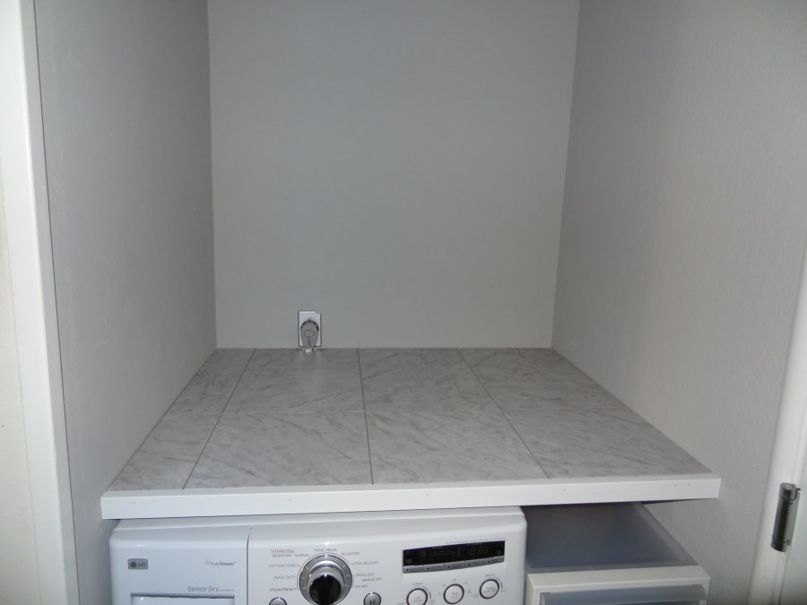 laundry makeover, laundry countertop using peel and stick vinyl tiles