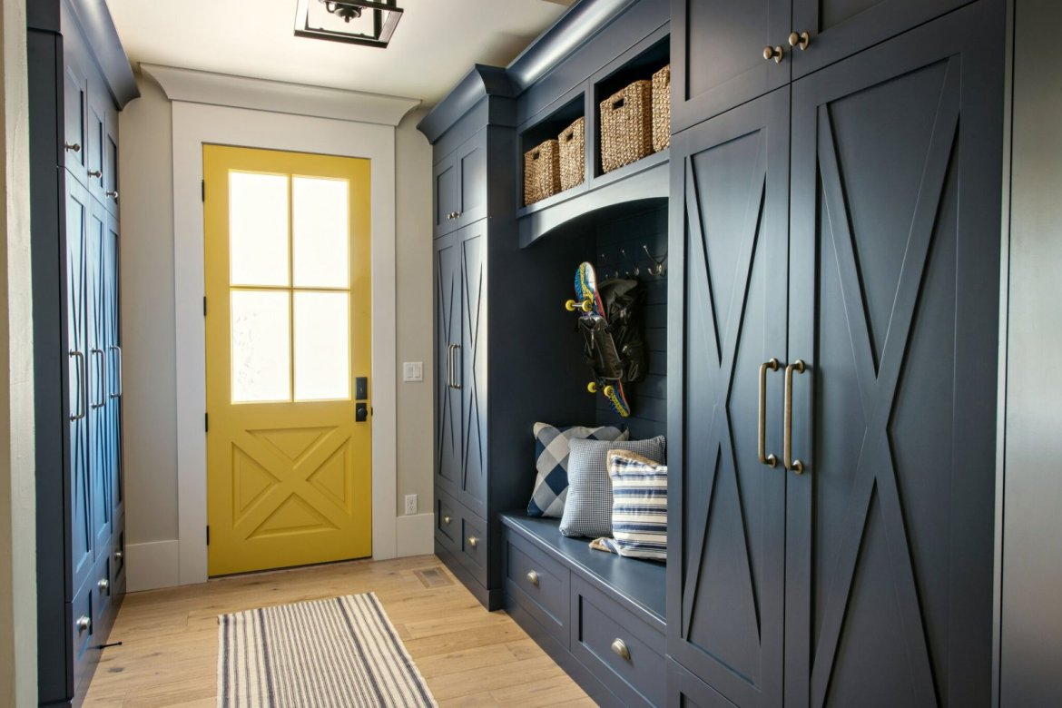 navy and yellow mudroom with bench