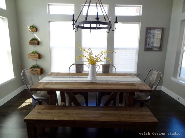 industrial farmhouse dining table with bench and metal chairs