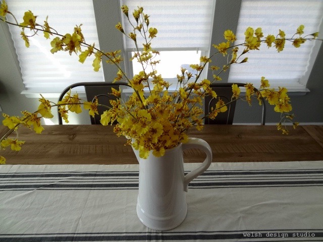farmhouse flowers in white pitcher