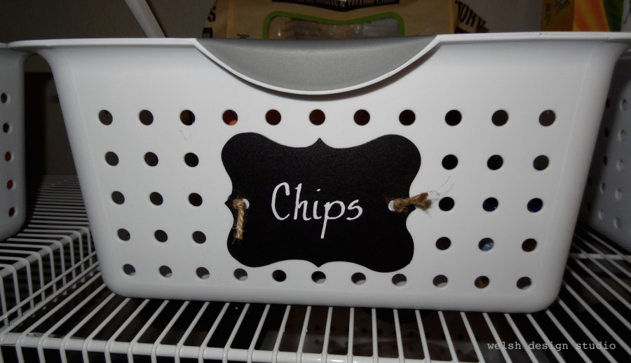 chalkbaord labels on baskets for pantry oraanization