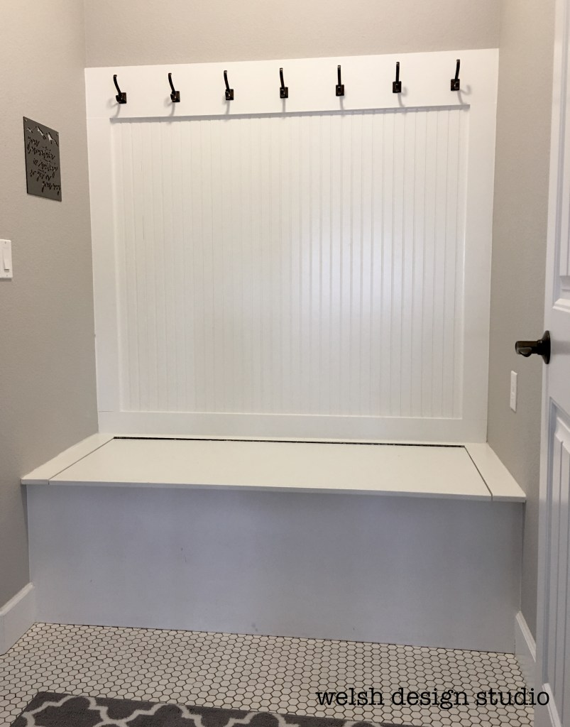 mudroom makeover with hinged bench