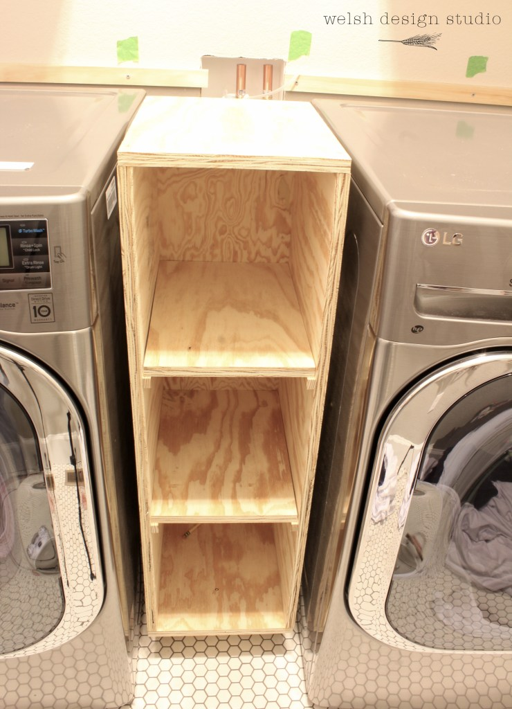 laundry room cabinet between washer and dryer