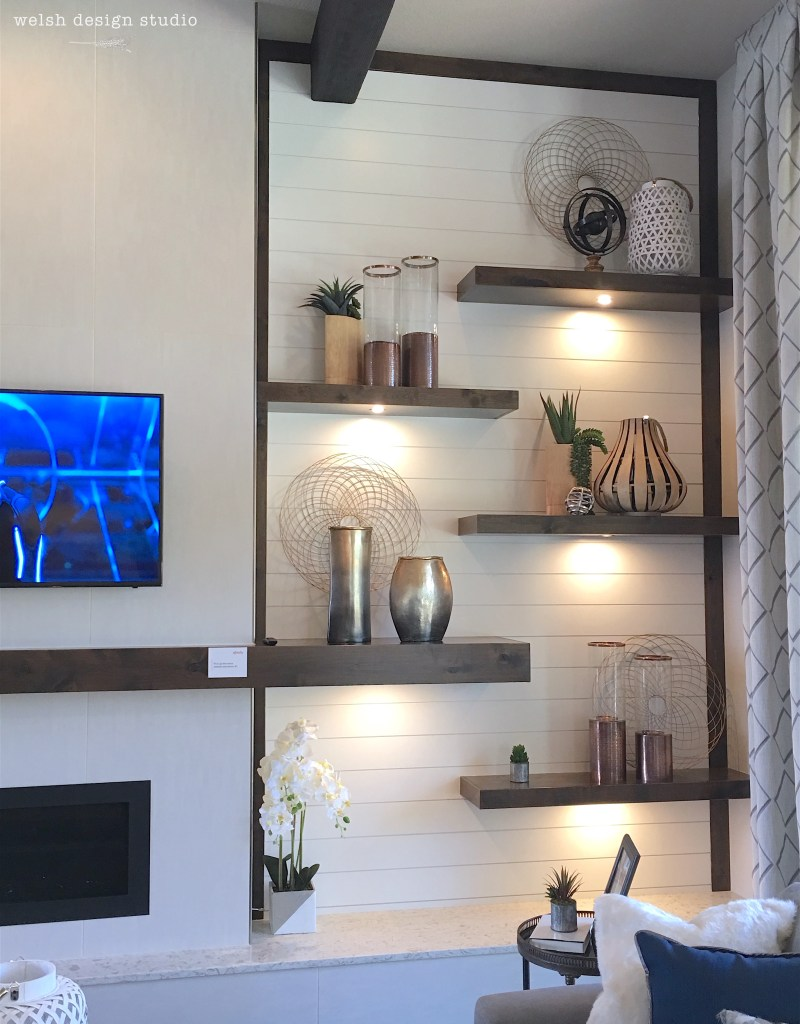 shiplap fireplace with floating shelves