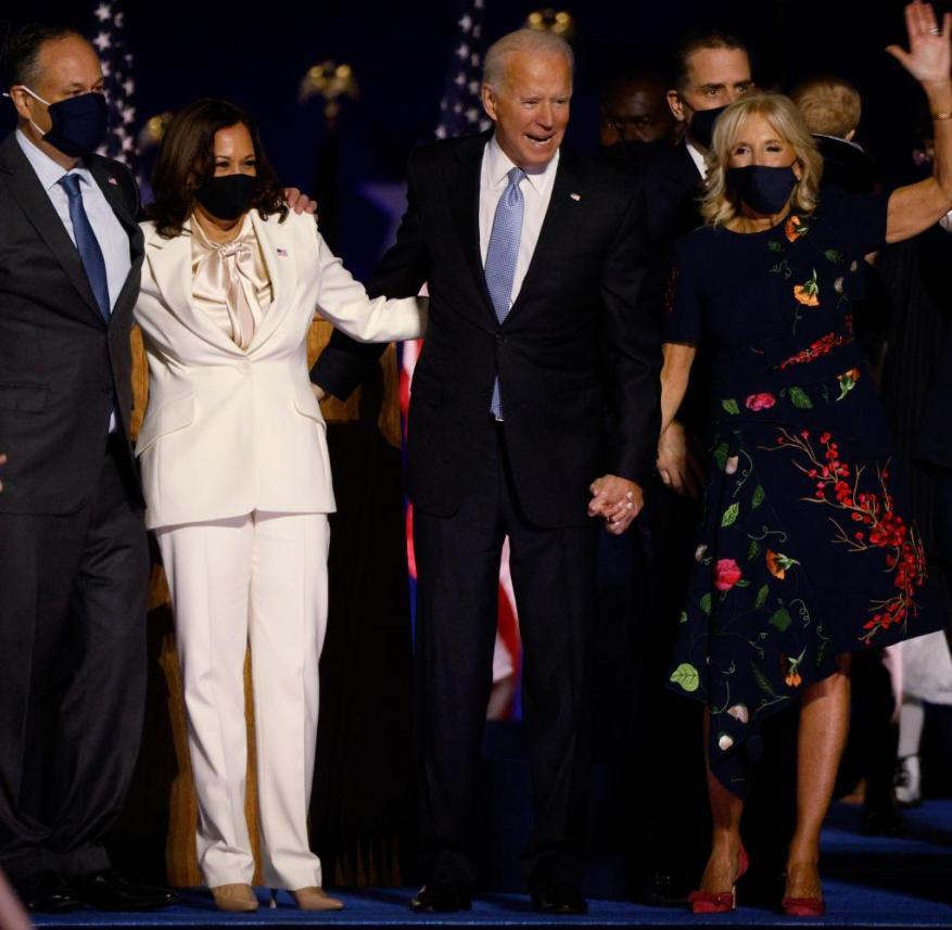 Democratic 2020 U.S. presidential nominee Joe Biden and vice presidential nominee Harris celebrate onstage at their election rally in Wilmington