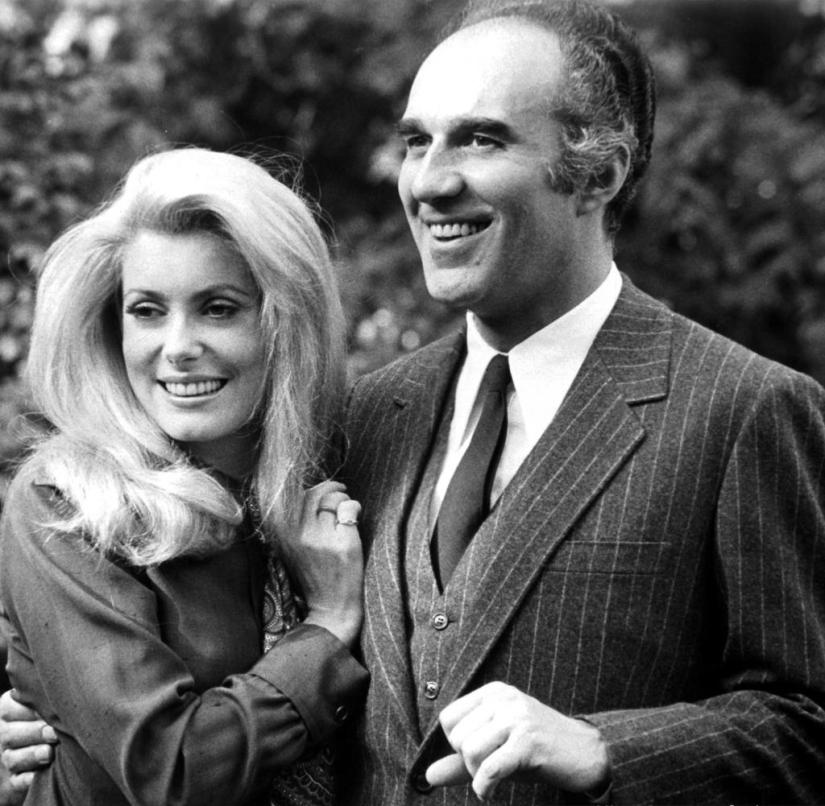 Michel Piccoli with his arm around Catherine Deneuve in scene from the film 'Heartbeat', 1968. (Photo by Lopert / Getty Images)