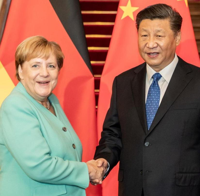 06.09.2019, China, Beijing: Chancellor Angela Merkel (CDU) is welcomed in the Zijin guest house by Xi Jinping, President of the People's Republic of China, before the start of a one-on-one talk. Merkel is on a two-day visit to the People's Republic of China. Photo: Michael Kappeler / dpa +++ dpa-Bildfunk +++ | Use worldwide