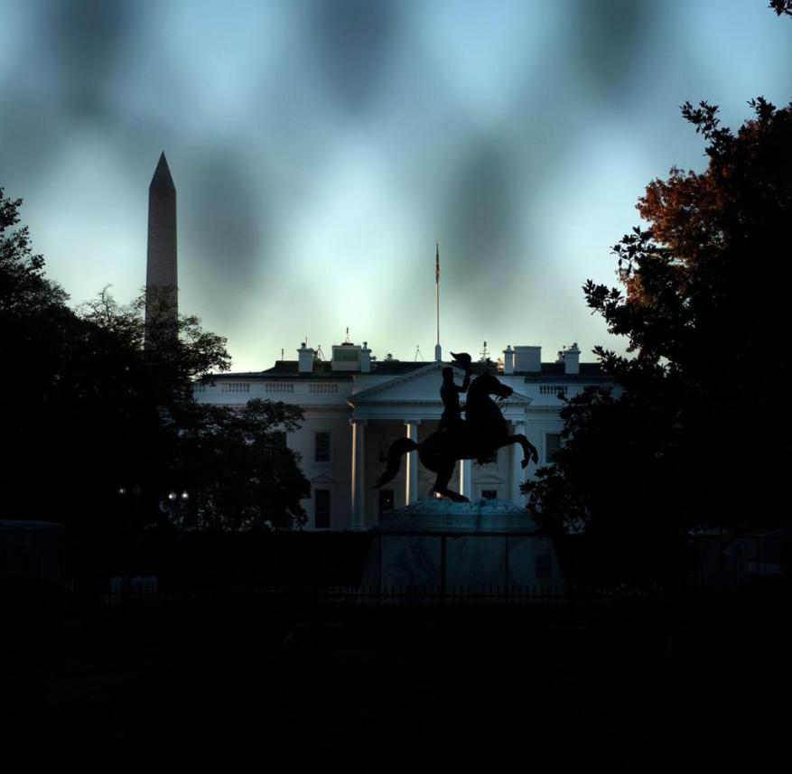 A view of the White House is seen through a temporary security fence as the 2020 US presidential election remains undecided on November 4, 2020, in Washington, DC. - President Donald Trump and Democratic challenger Joe Biden are battling it out for the White House, with polls closed across the United States -- and the American people waiting for results in key battlegrounds still up for grabs. (Photo by Brendan Smialowski / AFP)