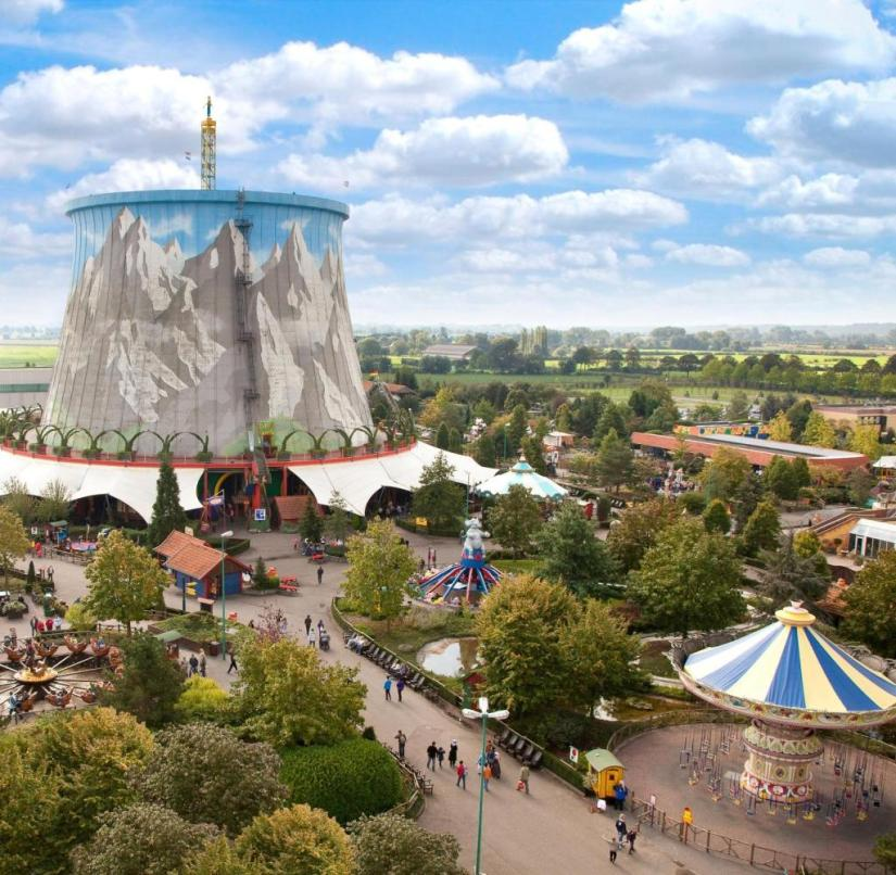 The cooling tower of the Kalkar nuclear power plant, painted with a lovely Alpine panorama, dominates today's amusement park on the Lower Rhine