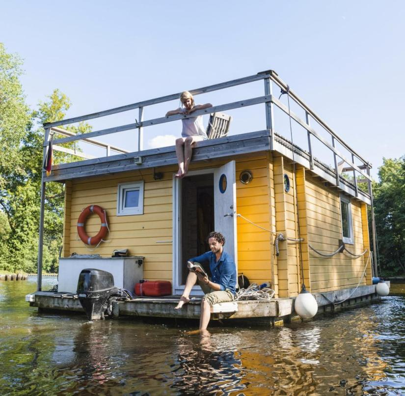 Houseboat rafts are popular even if some routes are closed to them and they move slowly