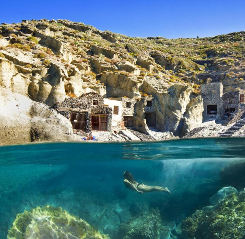 Salina: The village of Pollara with its boat houses carved into the rock and a bay for diving