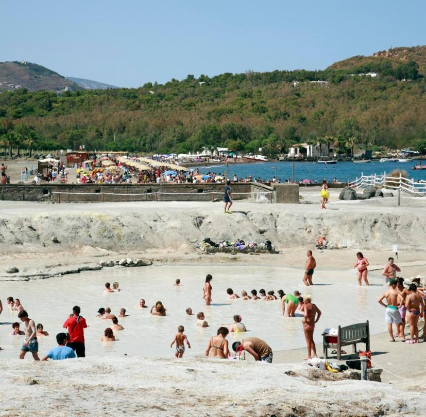 On Vulcano, tourists take a sulfur bath in the fango pool