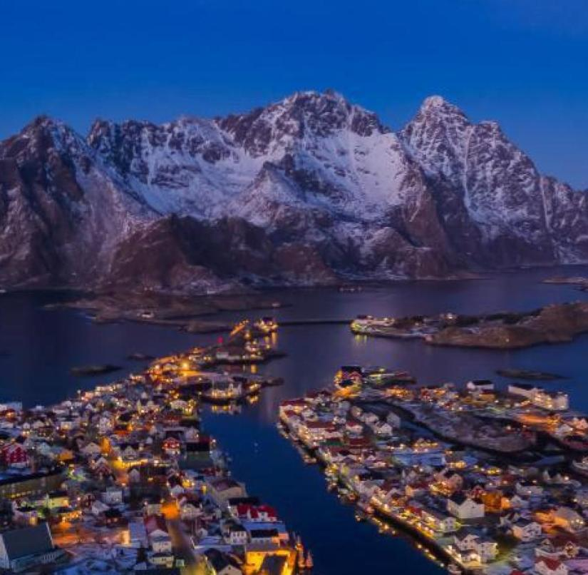 North of the Arctic Circle: Henningsvær in Lofoten shines in the evening sun