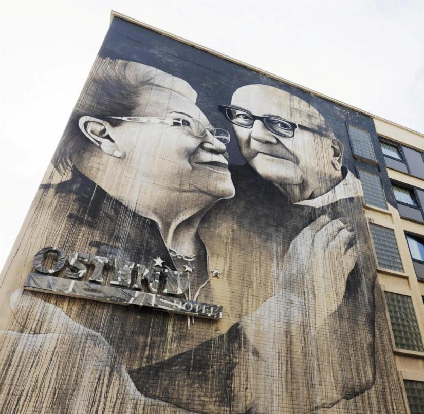 Ostend (Belgium): The happy senior couple by artist Ben Slow have been emblazoned on the wall of the
