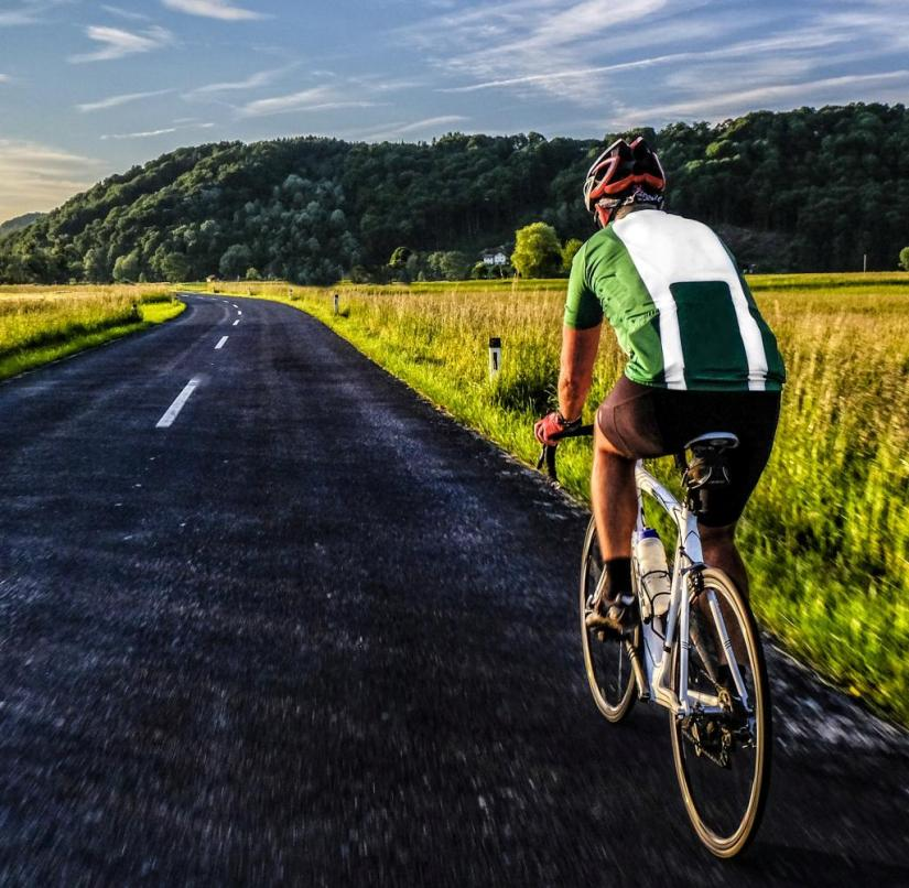 Germany, Bavaria, Chiemgau, racing biker on tour