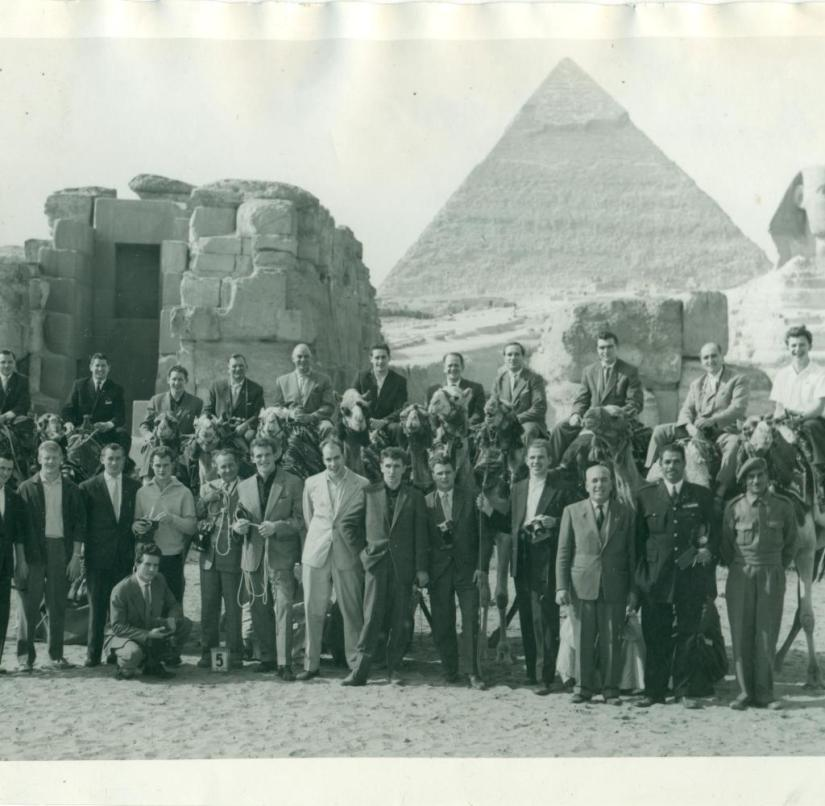 The German national team poses for a group picture in front of the sphinx and pyramid. Back row, fifth from right: national coach Sepp Herberger on a camel