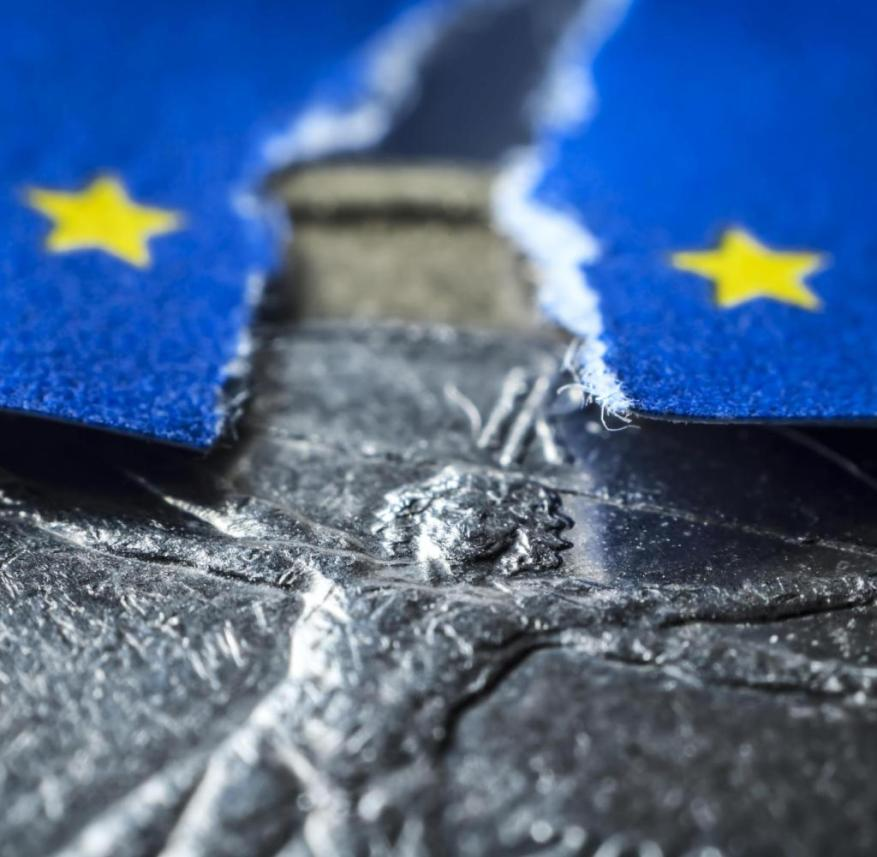 Italian euro coin and torn EU flag, symbolic photo Debt crisis in Italy  Use worldwide