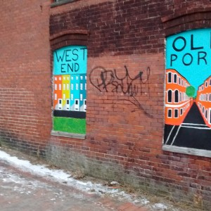 The nieghborhoods of Portland painted on a building in the East End.