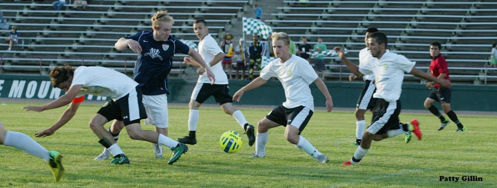 Hurt, second from right, in action with EPLWA Wenatchee FC this summer.