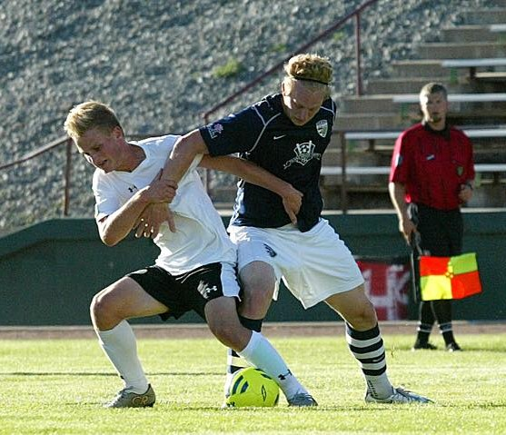 Elijah Hurt, at left, battles a South Sound FC opponent for the ball at Sargent Field in Chelan in Wenatchee FC's final match of the 2015 season. (Patty Gillin)