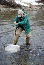Mark kicks up streambottom sediments, freeing resident invertebrates that float into the net.