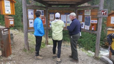 Barbee, Lisi, and Mark think about doing a walk-through the Enchantments before dinner.