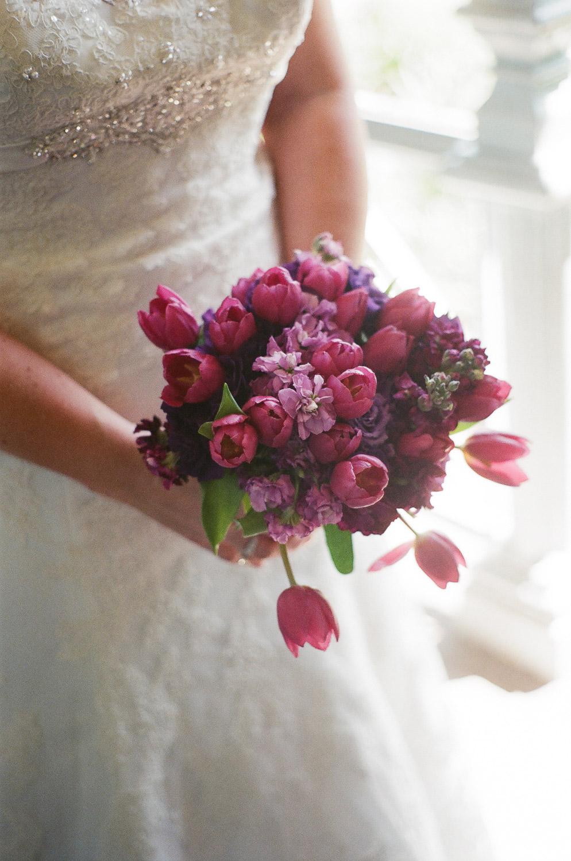 small wedding bouquet of purple tulips