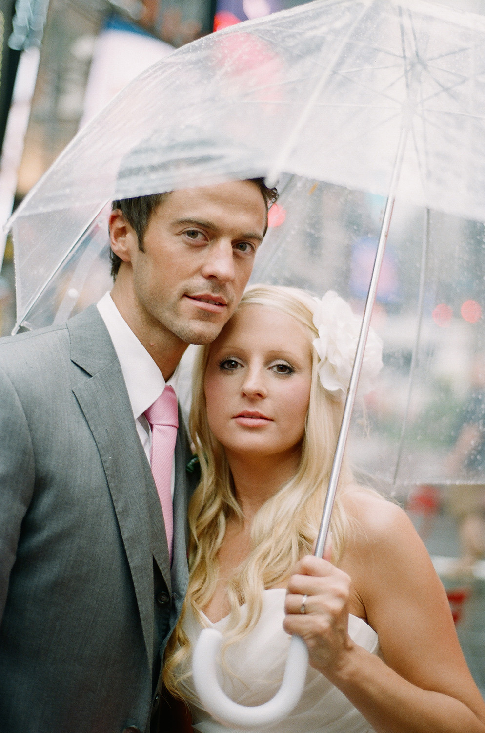 couple portrait in the rain with clear umbrella