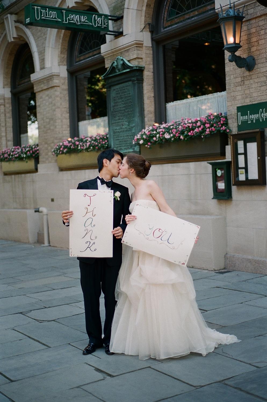 yale wedding couple kissing outside union league cafe wendy g photography