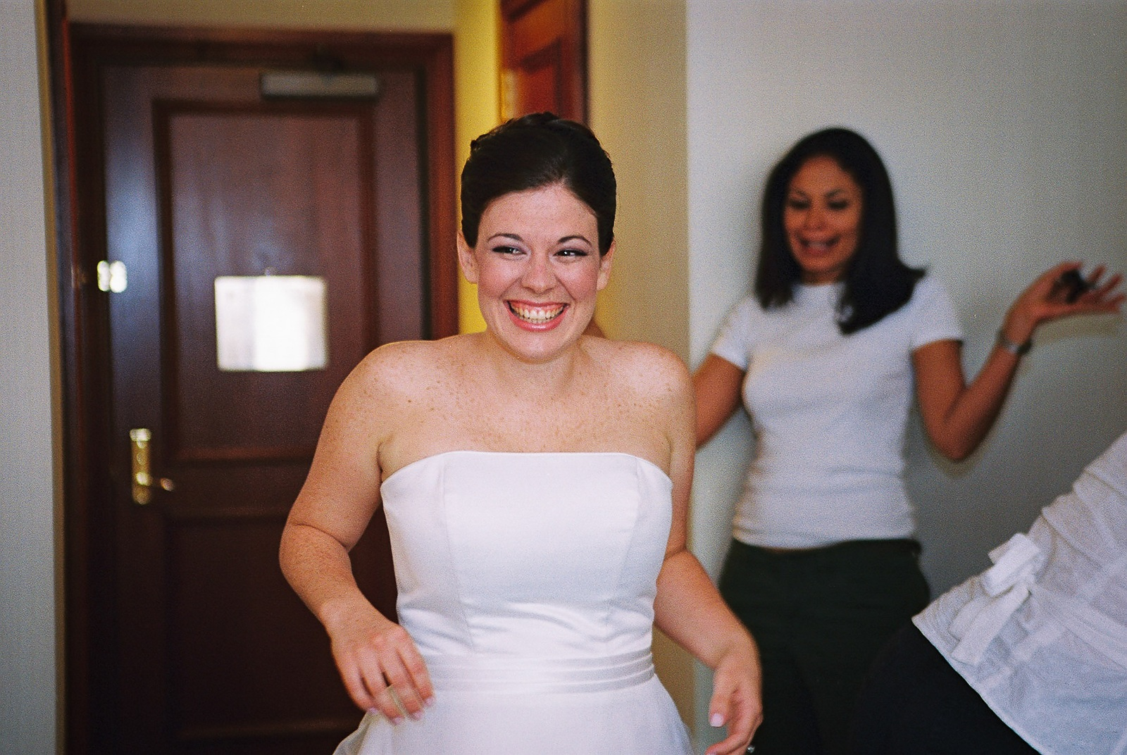 bride smiling from surprise gift