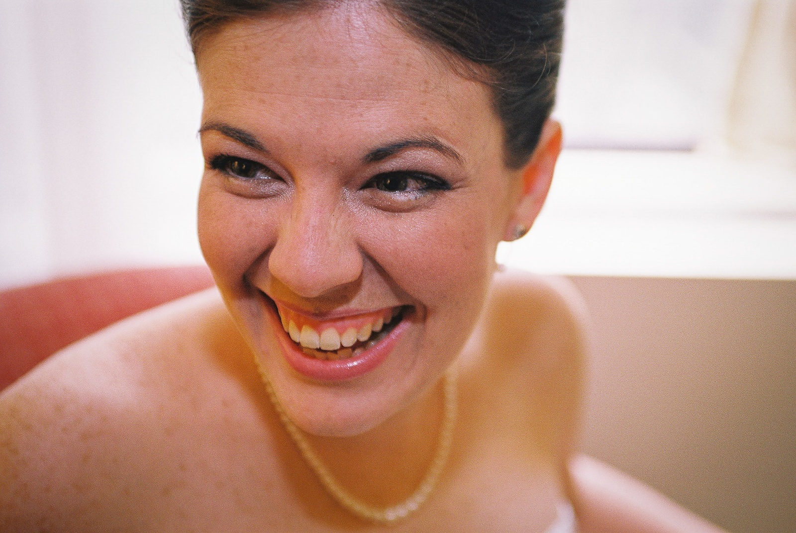 bride laughing in hotel room