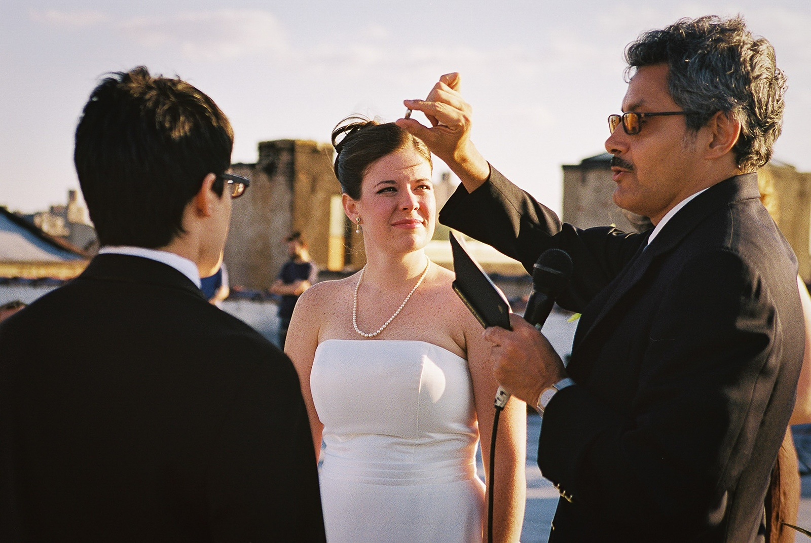 pastor holding up wedding band during ceremony