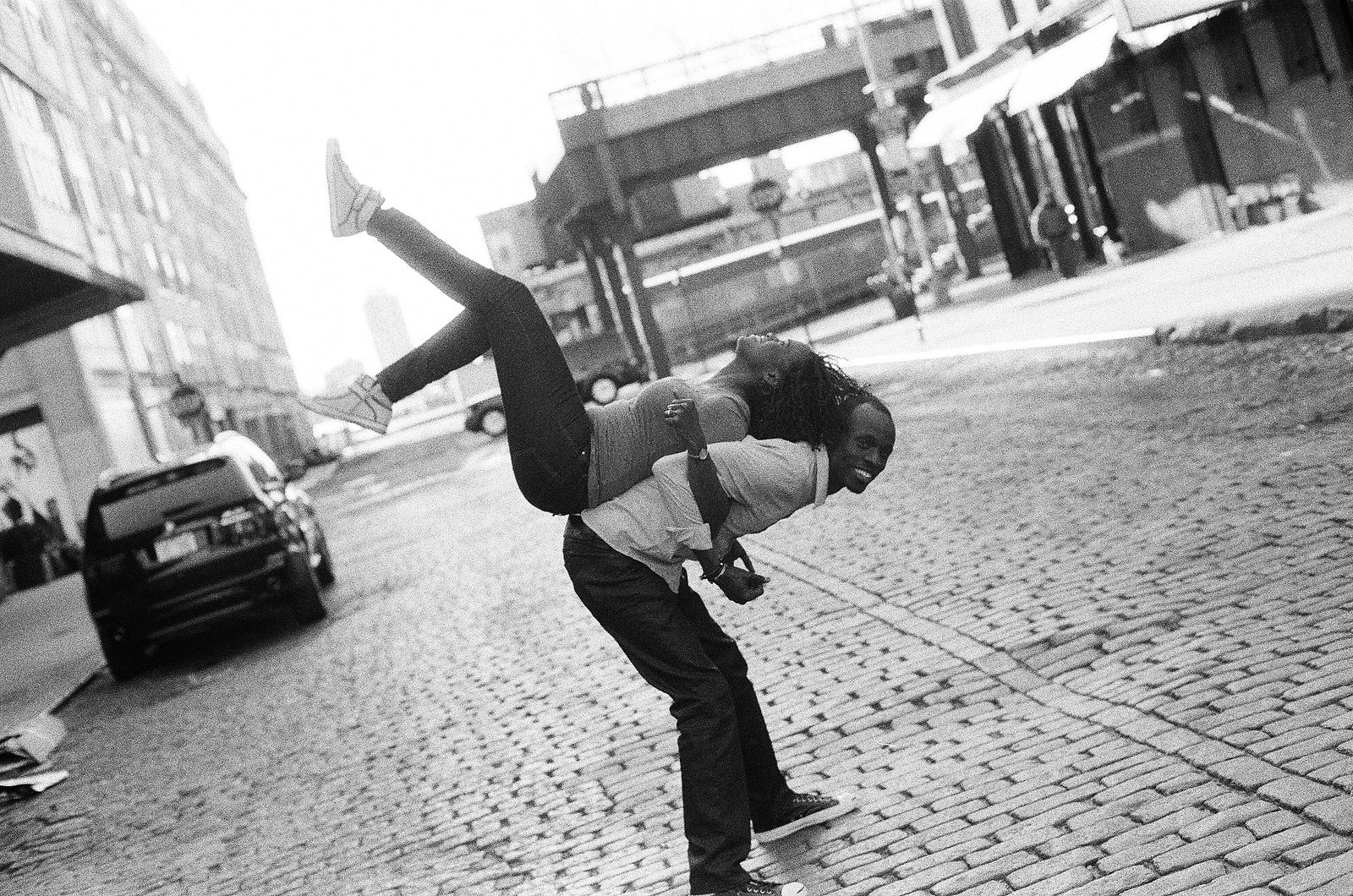 black and white photo engagement photo with bride on groom's back