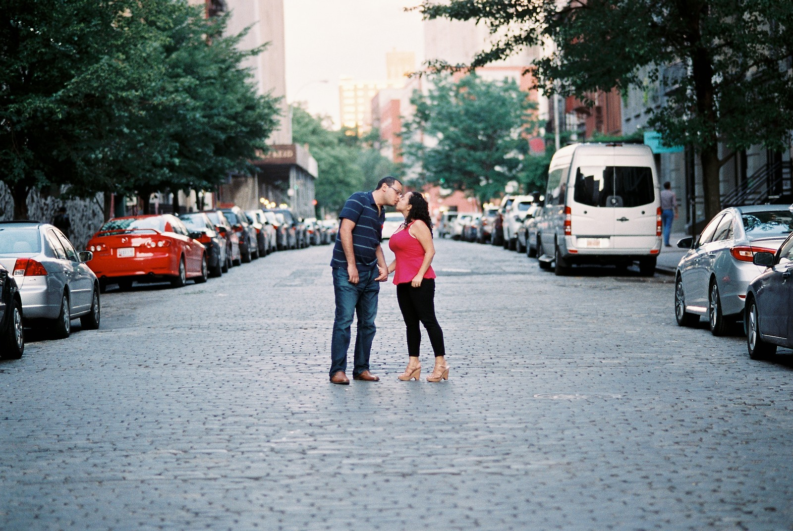engagement photo of couple kissing middle street downtown nyc