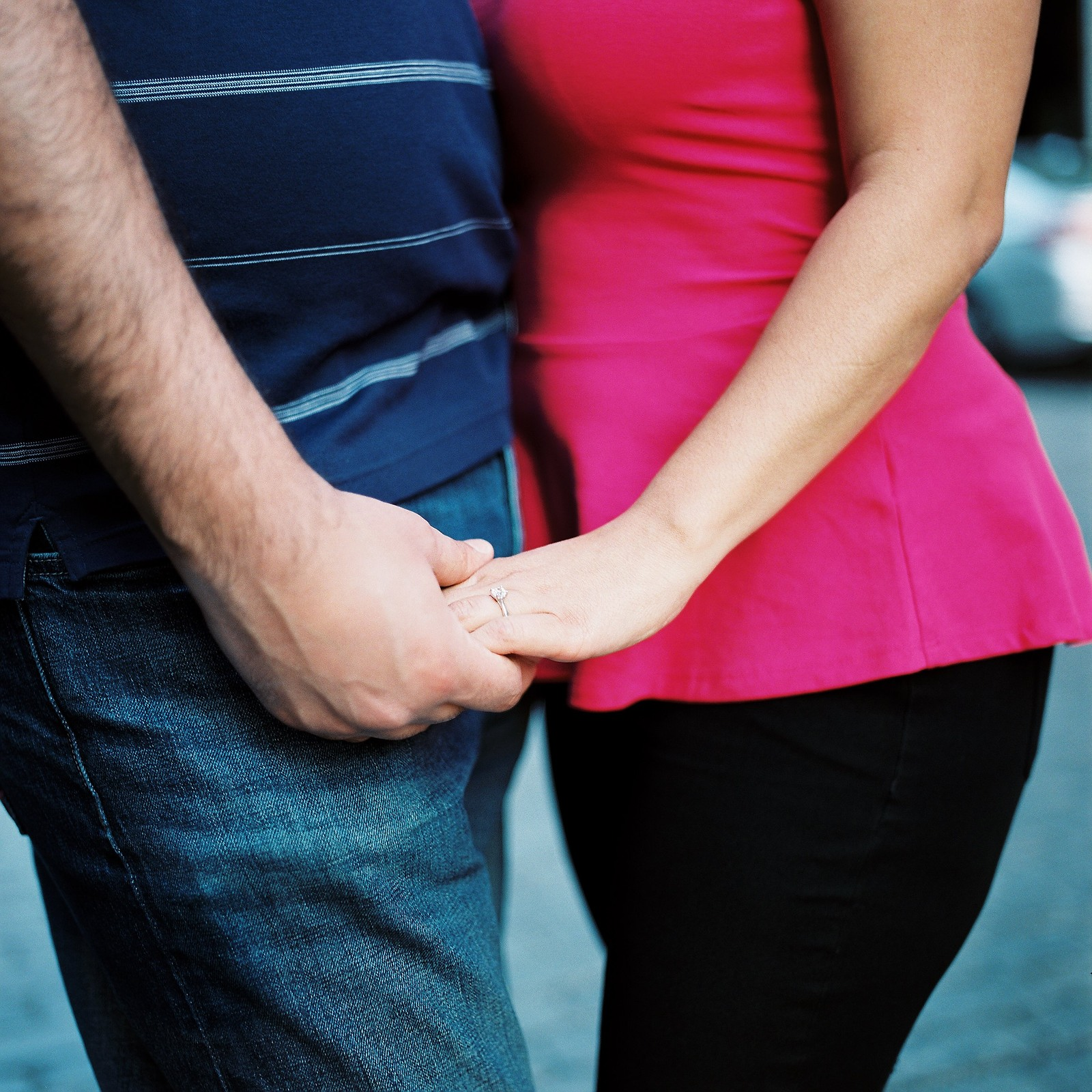 close up of hands and waists of engaged couple in nyc