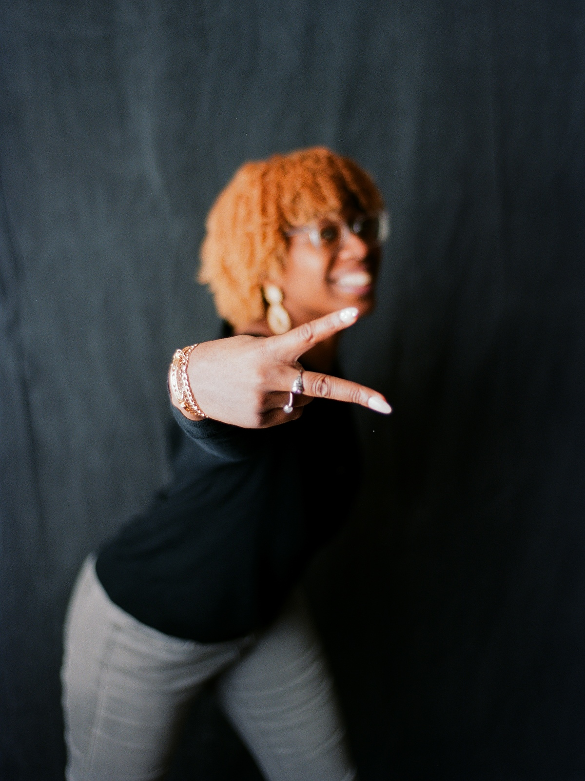 portrait with woman holding up peace sign